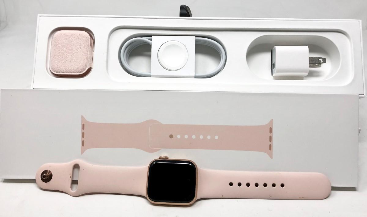 This is an elegant rose gold Apple watch with box and accessories
